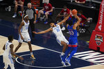 Kansas' Jalen Wilson (10) shoots next to Kentucky's Olivier Sarr (30) and is called for a foul during the second half of an NCAA college basketball game Tuesday, Dec. 1, 2020, in Indianapolis. (AP Photo/Darron Cummings)