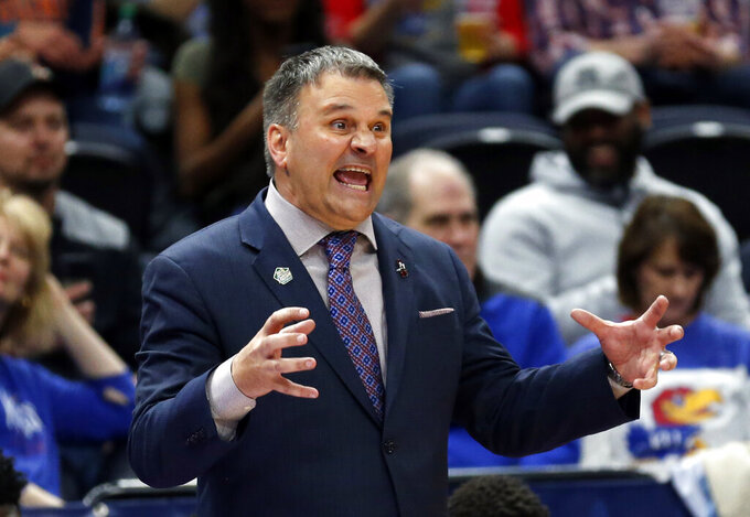New Mexico State head coach Chris Jans reacts in the second half during a first round men's college basketball game in the NCAA Tournament against Auburn, Thursday, March 21, 2019, in Salt Lake City. (AP Photo/Rick Bowmer)