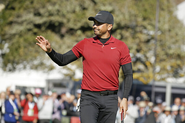 Jason Day, of Australia, waves after making a birdie putt on the 18th green of the Pebble Beach Golf Links during the second round of the AT&T Pebble Beach National Pro-Am golf tournament Friday, Feb. 7, 2020, in Pebble Beach, Calif. (AP Photo/Eric Risberg)