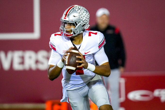 Ohio State quarterback C.J. Stroud (7) looks to throw during warmups before playing Indiana in an NCAA college football game in Bloomington, Ind., Saturday, Oct. 23, 2021. (AP Photo/AJ Mast)