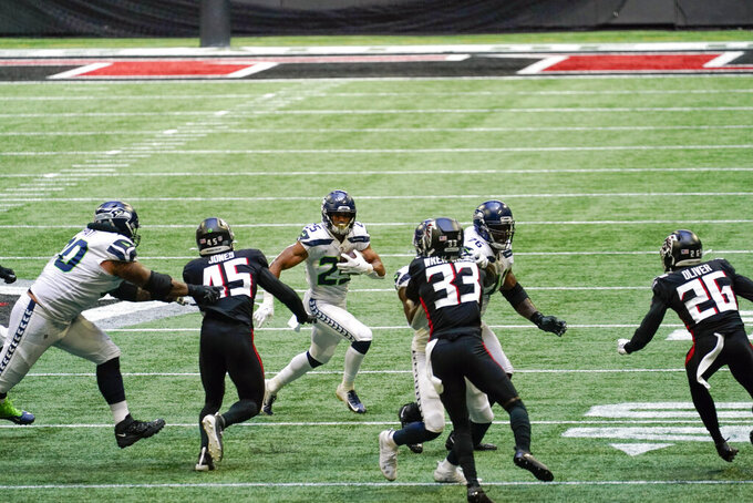 Seattle Seahawks running back Travis Homer (25) runs against the Atlanta Falcons during the second half of an NFL football game, Sunday, Sept. 13, 2020, in Atlanta. (AP Photo/Brynn Anderson)