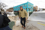2020 Democratic presidential candidate Washington Gov. Jay Inslee tours flood damage, Friday, April 12, 2019, in Hamburg, Iowa. (AP Photo/Charlie Neibergall)