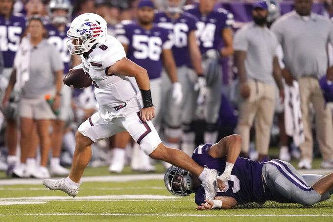 Southern Illinois quarterback Nic Baker (8) gets past Kansas State linebacker Ryan Henington (5) to run the ball during the first half of an NCAA college football game, Saturday, Sept. 11, 2021, in Manhattan, Kan. (AP Photo/Charlie Riedel)