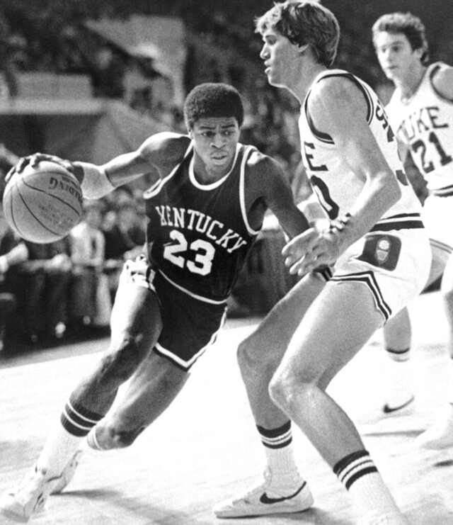 "FILE - University of Kentucky's Dwight Anderson drives past Duke University's Jim Suddath during the first half of an NCAA college basketball game in Springfield, Mass., Nov. 17, 1979. Dwight Anderson, who earned the nickname ""The Blur"