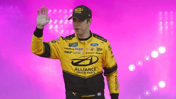 Brad Keselowski waves to fans during driver introductions prior to the start of the NASCAR Cup series auto race at Richmond Raceway in Richmond, Va., Saturday, April 13, 2019. (AP Photo/Steve Helber)