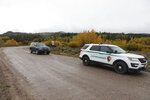 """A U.S. Park Ranger vehicle drives in the Spread Creek area in the Bridger-Teton National Forest, just east of Grand Teton National Park off U.S. Highway 89, Sunday, Sept. 19, 2021, in Wyoming. Authorities say they have found a body believed to be Gabrielle """"Gabby"""" Petito, who went missing on a trip with her boyfriend. (AP Photo/Amber Baesler)"""