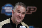 Purdue head coach Matt Painter speaks during a news conference for the men's NCAA Tournament college basketball South Regional final game, Friday, March 29, 2019, in Louisville, Ky. (AP Photo/Michael Conroy)
