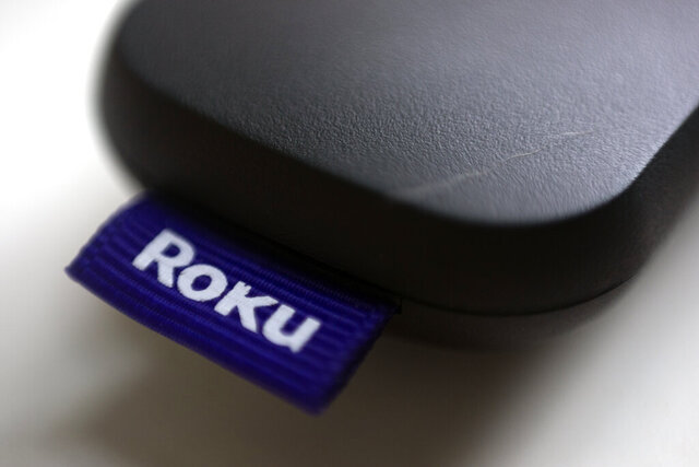 FILE - This Aug. 13, 2020 file photo shows a logo for Roku on a remote control in Portland, Ore.  On Friday, Jan. 8, 2021, Roku is buying short-lived streaming service Quibi's content library to bolster content for its free Roku Channel. Financial terms were undisclosed.  AP Photo/Jenny Kane, File)