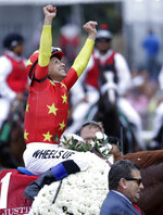 Jockey Mike Smith reacts after guiding Justify to win the 150th running of the Belmont Stakes horse race, Saturday, June 9, 2018, in Elmont, N.Y. (AP Photo/Julio Cortez)