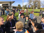 Parents of students at Cascade Middle School wait outside St. Mark's Catholic Church to be reunited with their middle school children in Eugene, Ore., Friday, Jan. 11, 2019. A suspect was shot Friday at nearby Cascade Middle School but no students or teachers were hurt, police said. Students were locked in classrooms and no one was being allowed into the building during the lockdown, Eugene police Lt. Jennifer Bills told reporters. (AP Photo/Andrew Selsky)
