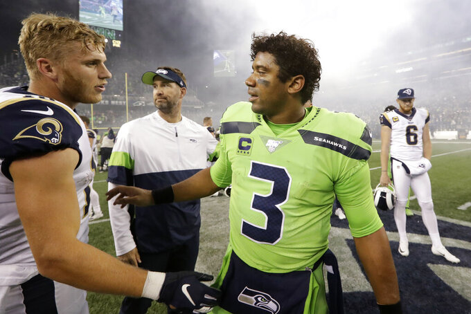 Seattle Seahawks quarterback Russell Wilson (3) greets Los Angeles Rams' Cooper Kupp after an NFL football game Thursday, Oct. 3, 2019, in Seattle. The Seahawks won 30-29. (AP Photo/Elaine Thompson)