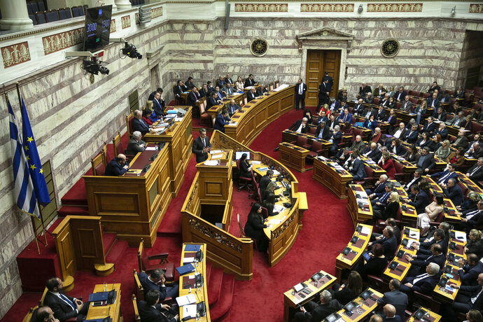 Greece's Prime Minister Kyriakos Mitsotakis, delivers a speech during a parliament session in Athens, on Wednesday, Dec. 18, 2019. Greek lawmakers debate on the state budget for 2020. (AP Photo/Yorgos Karahalis)