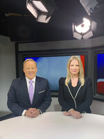 In this image released by Newsmax, co-hosts Sean Spicer and Lyndsay Keith pose for a photo on the set of