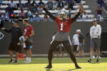 Carolina Panthers quarterback Cam Newton dances to entertain the crowd during practice at the NFL football team's training camp in Spartanburg, N.C., Thursday, July 25, 2019. (AP Photo/Chuck Burton)
