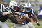 Duke defensive tackle Trevon McSwain (95) and linebacker Joe Giles-Harris, right, move in to tackle Virginia running back Jordan Ellis during the first half of an NCAA college football game in Durham, N.C., Saturday, Oct. 20, 2018. (AP Photo/Gerry Broome)