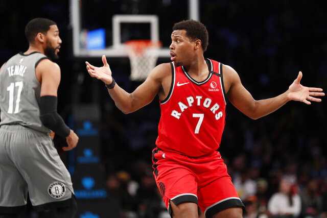 Toronto Raptors guard Kyle Lowry (7) reacts as he is called for a foul, his fourth, during the second half of an NBA basketball game against the Brooklyn Nets, Wednesday, Feb. 12, 2020, in New York. The Nets won 101-91. (AP Photo/Kathy Willens)