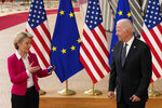 European Commission President Ursula von der Leyen, left, speaks witih U.S. President Joe Biden during arrival for the EU-US summit at the European Council building in Brussels, Tuesday, June 15, 2021. (AP Photo/Francisco Seco)