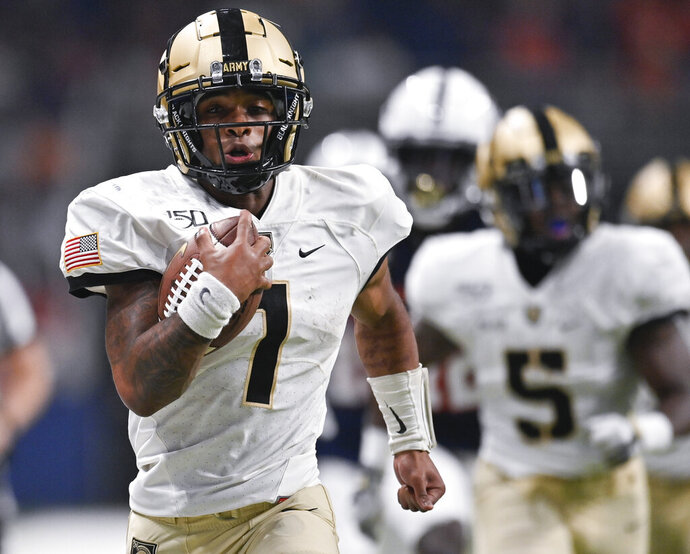 Army quarterback Jabari Laws runs for a touchdown during the second half of an NCAA college football game against UTSA, Saturday, Sept. 14, 2019 in San Antonio. (AP Photo/Darren Abate)