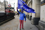An anti-Brexit protester waves an EU flag, near Parliament Square, in London, Wednesday, May 26, 2021. (AP Photo/Alberto Pezzali)