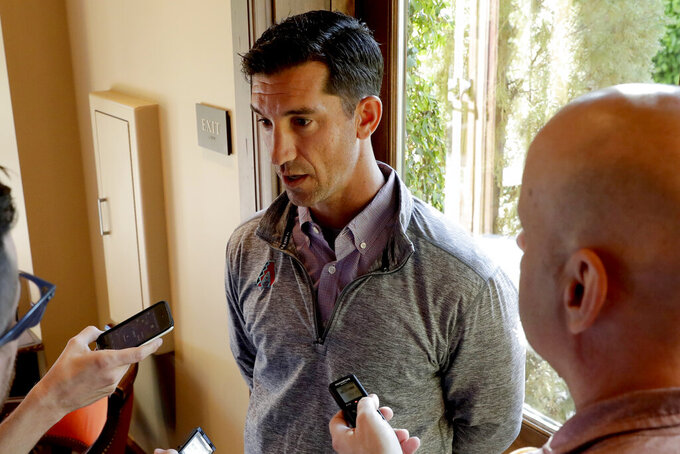 FILE - In this Tuesday, Nov. 12, 2019, file photo, Arizona Diamondbacks general manager Mike Hazen speaks during a media availability during the Major League Baseball general managers annual meetings, in Scottsdale, Ariz. Baseball's bubble-free environment is an anomaly as the sports world tries to come back amid the ongoing coronavirus pandemic. Hazen says he'll be constantly reminding everyone in his organization about the delicacy of the current situation. (AP Photo/Matt York, File)