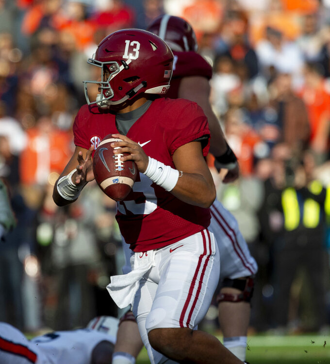Alabama quarterback Tua Tagovailoa (13) rolls out against Auburn during the first half of an NCAA college football game, Saturday, Nov. 24, 2018, in Tuscaloosa, Ala. (AP Photo/Vasha Hunt)