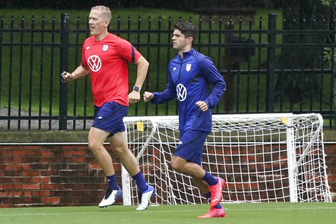 Christian Pulisic, right, works out during a soccer practice for the U.S. Men's National Team Tuesday, Aug. 31, 2021, in Nashville, Tenn. (AP Photo/Mark Humphrey)