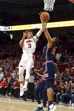 Arkansas guard Desi Sills(3) shoots as Auburn's Austin Wiley defends during the first half of an NCAA college basketball game Tuesday, Feb. 4, 2020, in Fayetteville, Ark. (AP Photo/Michael Woods)
