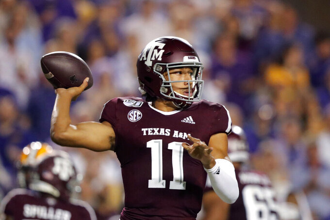 FILE - In this Nov. 30, 2019 file photo, Texas A&M quarterback Kellen Mond (11) throws a pass during the first half of the team's NCAA college football game against LSU in Baton Rouge, La. The coronavirus pandemic has shut down much of Division I football, but with three of the Power Five leagues still playing, there are still some big games to look forward to. Florida faces a tough test on Oct. 10, 2020, at Texas A&M.  (AP Photo/Gerald Herbert, File)
