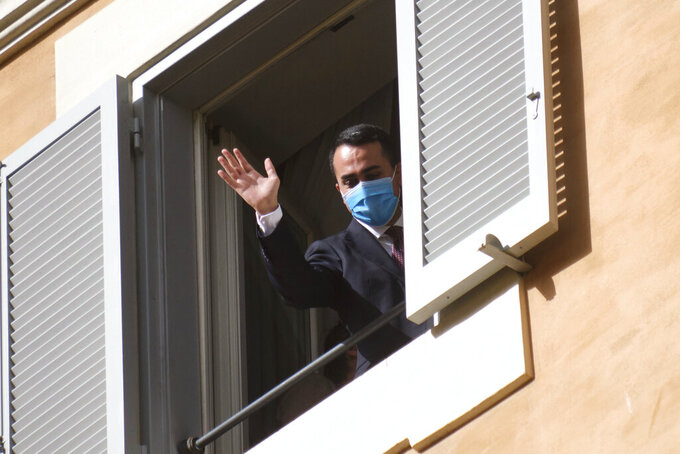 Five-Star Movement's Luigi Di Maio waves after meeting Mario Draghi, at the Chamber of Deputies in Rome, Saturday, Feb. 6, 2021. Former European Central Bank chief Draghi is consulting Italy's fractious parties after being tapped by President Sergio Mattarella to try to pull together a government to guide the debt-riddled country through the health and economic crises it is confronting. (Mauro Scrobogna/LaPresse via AP)
