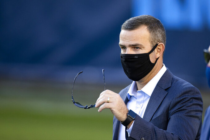 FILE - In this Oct. 13, 2020, file photo, Buffalo Bills general manager Brandon Beane walks on the field before an NFL football game against the Tennessee Titans in Nashville, Tenn. The Bills signed Beane to a multi-year contract extension on Thursday, Dec. 10, 2020, in locking up the architect of a team in position to secure its third playoff berth in four years. (AP Photo/Brett Carlsen, File)
