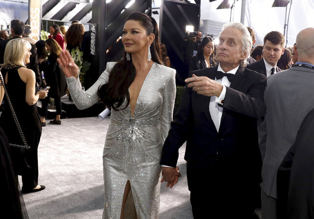 FILE - In this Jan. 19, 2020 file photo, Catherine Zeta-Jones and Michael Douglas arrive at the 26th annual Screen Actors Guild Awards, in Los Angeles, California. Hollywood power couple Michael Douglas and Catherine Zeta-Jones are set to return to Israel as co-hosts of this year's prestigious Genesis Prize ceremony. The Genesis Prize Foundation announced Wednesday, Feb 25, 2020, that the pair would co-host the June 18 event, where former Soviet dissident and Israeli politician Natan Sharansky is to be honored as the 2020 laureate. Douglas himself was the 2015 winner of the $1 million prize, granted each year in recognition of professional achievement, contribution to humanity and commitment to Jewish values and Israel. (Photo by Matt Sayles/Invision/AP, File)