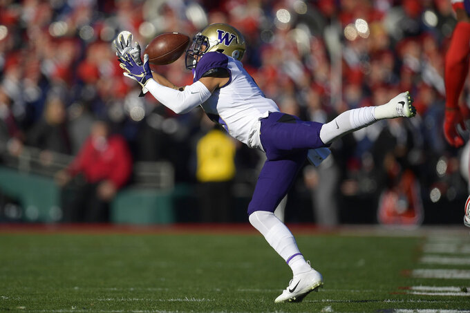 Washington wide receiver Andre Baccellia can't hang onto a pass during the first half of the Rose Bowl NCAA college football game against Ohio State, Tuesday, Jan. 1, 2019, in Pasadena, Calif. (AP Photo/Mark J. Terrill)