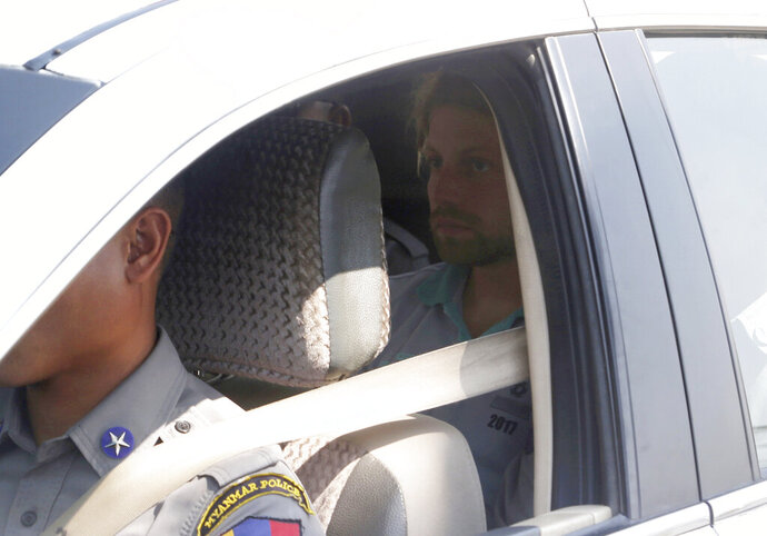 Arthur Desclaux sits in the back of a police car as it arrives at court in Naypyitaw, Myanmar, Friday, Feb. 22, 2019. The French national appeared in court after being arrested two weeks ago for allegedly flying a drone close to the country's vast parliament complex. Desclaux faces a charge under the Illegal Export-Import Act and could be jailed for up to three years if convicted. (AP Photo/Aung Shine Oo)