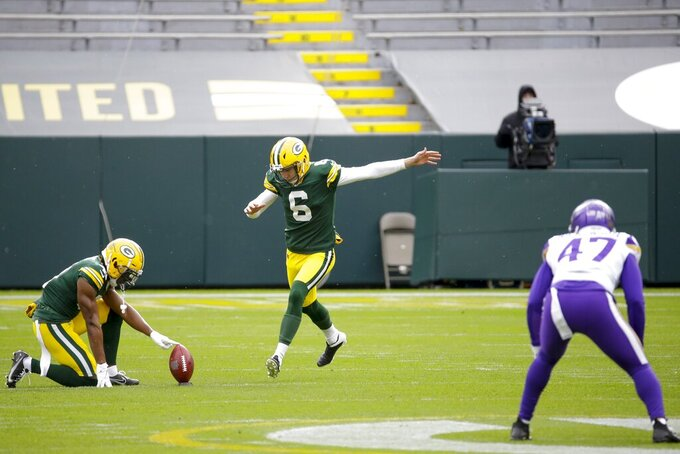 Green Bay Packers punter J.K. Scott kicks off during the first half of an NFL football game against the Minnesota Vikings Sunday, Nov. 1, 2020, in Green Bay, Wis. (AP Photo/Mike Roemer)