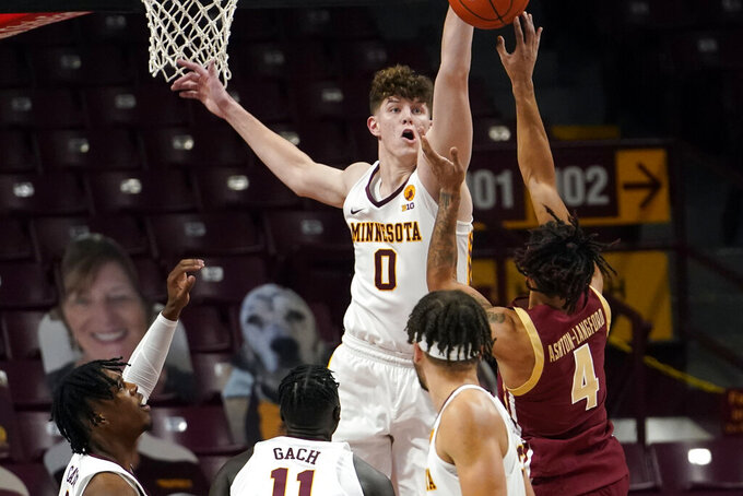 Minnesota's Liam Robbins (0) blocks a shot by Boston College's Makai Ashton-Langford (4) during the first half of an NCAA college basketball game Tuesday, Dec. 8, 2020, in Minneapolis. (AP Photo/Jim Mone)