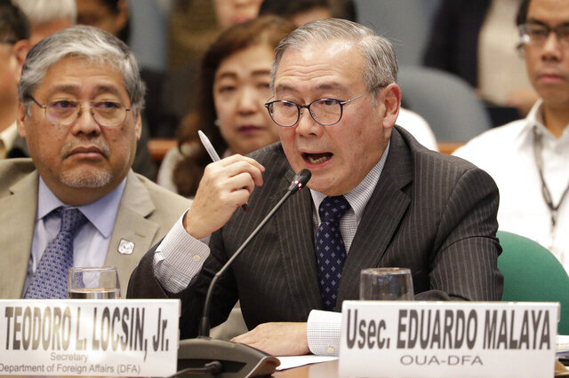 FILE - In this Feb. 6, 2020, file photo, Philippine Secretary of Foreign Affairs Teodoro Locsin Jr. gestures during a senate hearing in Manila, Philippines.  Philippine President Rodrigo Duterte has suspended his decision to terminate a key defense pact with the United States, at least temporarily avoiding a major blow to one of America's oldest alliances in Asia. Locsin Jr. said Tuesday, June 2, 2020, he dispatched a diplomatic note to the U.S. ambassador in Manila informing the U.S. government that the Philippines is delaying its decision to abrogate the Visiting Forces Agreement by at least six months.  (AP Photo/Aaron Favila, File)