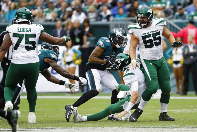 Philadelphia Eagles' Orlando Scandrick (38) strips the ball from New York Jets' Luke Falk (8) for an eventual touchdown during the second half of an NFL football game, Sunday, Oct. 6, 2019, in Philadelphia. (AP Photo/Matt Rourke)