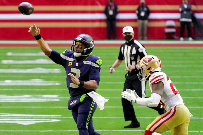 Seattle Seahawks quarterback Russell Wilson (3) throws as =fduring the first half of an NFL football game, Sunday, Jan. 3, 2021, in Glendale, Ariz. (AP Photo/Rick Scuteri)