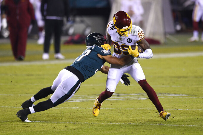 Washington Football Team's Cam Sims (89) is tackled by Philadelphia Eagles' T.J. Edwards (57) during the first half of an NFL football game, Sunday, Jan. 3, 2021, in Philadelphia. (AP Photo/Derik Hamilton)