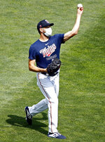 Minnesota Twins' Rich Hill throws in practice at a baseball camp Friday, July 3, 2020, in Minneapolis. (AP Photo/Bruce Kluckhohn)