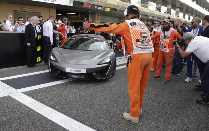 Racing greats Alonso and Johnson drive together in Abu Dhabi