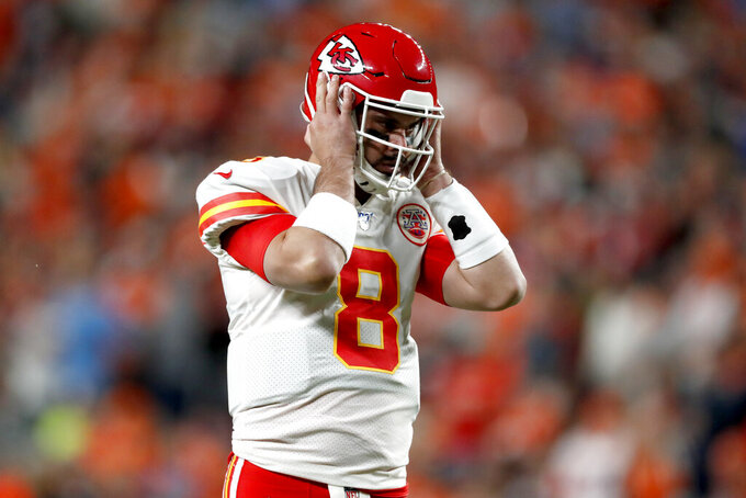 Kansas City Chiefs quarterback Matt Moore (8) takes the field to replace the injured Patrick Mahomes during the first half of an NFL football game against the Denver Broncos, Thursday, Oct. 17, 2019, in Denver. (AP Photo/David Zalubowski)