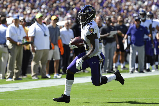 Baltimore Ravens running back Justice Hill rushes the ball in the first half of an NFL football game against the Arizona Cardinals, Sunday, Sept. 15, 2019, in Baltimore. (AP Photo/Nick Wass)