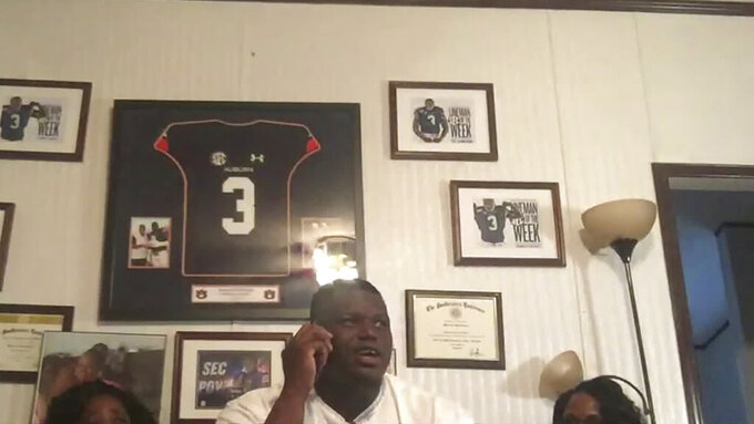 In this still image from video provided by the NFL, Marlon Davidson talks on the phone and is selected by the Atlanta Falcons during the second round of the NFL football draft, Friday, April 24, 2020. (NFL via AP)