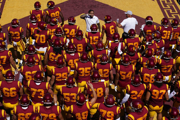 Southern California players enter the stadium before an NCAA college football game against San Jose State Saturday, Sept. 4, 2021, in Los Angeles. (AP Photo/Ashley Landis)