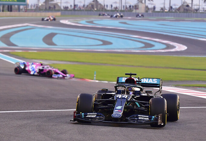 Mercedes driver Lewis Hamilton of Britain in action during the Formula One Abu Dhabi Grand Prix in Abu Dhabi, United Arab Emirates, Sunday, Dec. 13, 2020. (Giuseppe Cacace, Pool via AP)