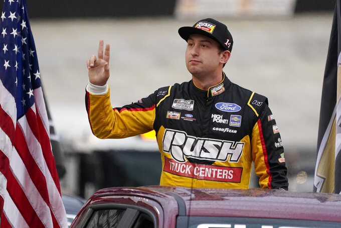 Chase Briscoe waves to fans before a NASCAR Cup Series auto race at Bristol Motor Speedway Saturday, Sept. 18, 2021, in Bristol, Tenn. (AP Photo/Mark Humphrey)