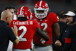 Georgia defensive back Richard LeCounte (2) celebrates with Georgia coach Kirby Smart after making an interception in the first half of a NCAA football game between Georgia and Missouri in Athens, Ga., on Saturday, Nov. 9, 2019. (Joshua L. Jones/Athens Banner-Herald via AP)