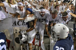 Penn State linebacker Brandon Smith (12, with blue head covering) celebrates with fans following the team's 28-20 victory over Auburn in an NCAA college football game in State College, Pa., on Saturday, Sept.18, 2021. (AP Photo/Barry Reeger)