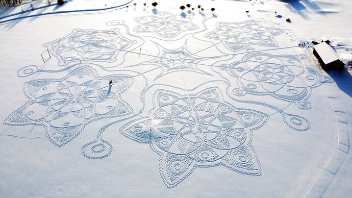 A giant complex geometric pattern formed from thousands of footsteps in the snow near to the capital Helsinki, in Espoo, Finland, Sunday Feb. 7, 2021. Under the guidance of an amateur artist Janne Pyykko, 11 snowshoe-clad volunteers stamped a series of complex geometric patterns on a golf course. Together, the designs resemble a huge snowflake. The artwork measures about 160 meters (525 feet) in diameter. (Janne Pyykko via AP)